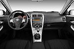 Straight dashboard view of a 2010 Toyota Corolla Linea Sol 4 Door Sedan.