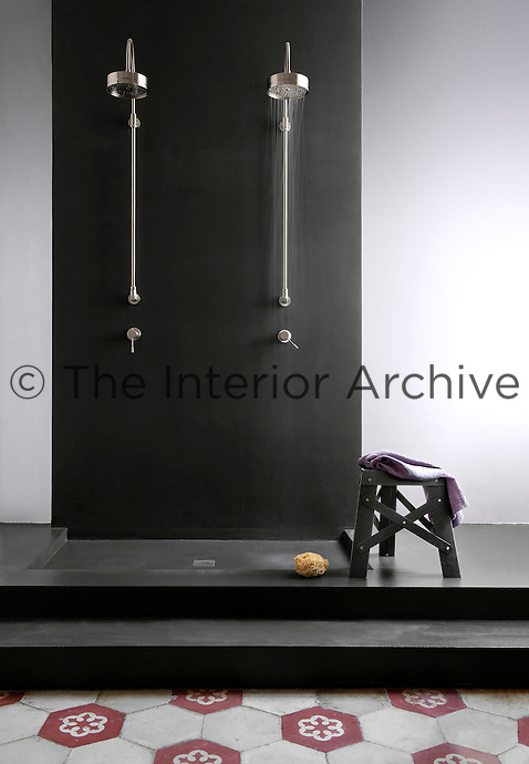 A double shower in anthracite coloured resin adds drama to this bathroom