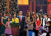"""United States President Barack Obama, first lady Michelle Obama and daughters Malia and Sasha are joined by entertainers (L-R) Jennifer Hudson, Victoria Justice and Justin Bieber for a final song at the conclusion of the performances at the annual """"Christmas in Washington"""" gala, December 11, 2011, Washington, DC.  .Credit: Mike Theiler / Pool via CNP"""