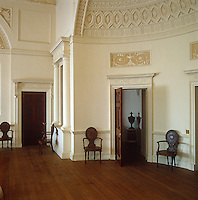 The grand hall is decorated in the neo-classical style with ornamental plasterwork and domed ceilings