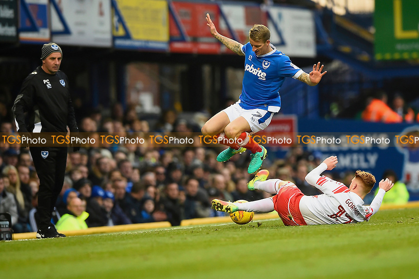 Dale Gorman of Stevenage makes a tackle on Carl Baker of Portsmouth as Portsmouth Manager Paul Cook watches  on during Portsmouth vs Stevenage, Sky Bet EFL League 2 Football at Fratton Park on 26th November 2016