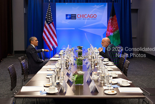 United States President Barack Obama talks with President Hamid Karzai of Afghanistan during the NATO Summit in Chicago, Illinois, May 20, 2012. .Mandatory Credit: Pete Souza - White House via CNP