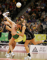 21.07.2007 Silver Ferns Joline Henry (L), Casey Williams and Australian Sharelle McMahon clash during the Silver Ferns v Australia Netball Test Match at Vodafone Arena, Melbourne Australia. Mandatory Photo Credit ©Michael Bradley.