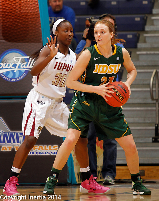 SIOUX FALLS, SD - MARCH 8:  Liz Keena #21 of North Dakota State shields the ball from IUPUI defender Akilah Sims #30 during their quarterfinal game at the 2014 Summit League Basketball Championships at the Sioux Falls Arena.  (Photo by Dick Carlson/Inertia)