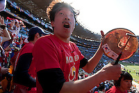 A South Korea fan beats a symbol while singing with other fans at Soccer City in Johannesburg, South Africa on Thursday, June 17, 2010 during Argentina's and South Korea FIFA World Cup first round match.
