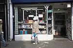 Muslim man looking at shop window display, Brick Lane, East End, London, England