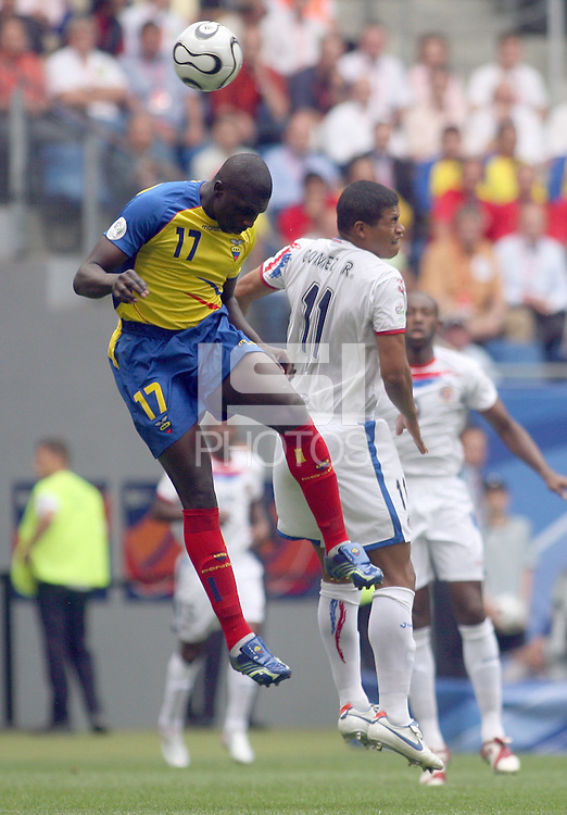 Ecuador's Giovanny Espinoza (17) and Costa Rica's Ronald Gomez (11) go up for a header. Ecuador defeated Costa Rica 3-0 in their FIFA World Cup Group A match at FIFA World Cup Stadium, Hamburg, Germany, June 15, 2006.