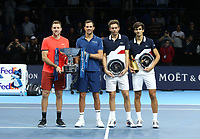 Nicolas Mahut and Pierre-Hughes Herbert (right) with their runners-up trophy and Jack Sock and Mike Bryan (left) with their winners trophy<br /> <br /> Photographer Rob Newell/CameraSport<br /> <br /> International Tennis - Nitto ATP World Tour Finals Day 8 - O2 Arena - London - Sunday 18th November 2018<br /> <br /> World Copyright &copy; 2018 CameraSport. All rights reserved. 43 Linden Ave. Countesthorpe. Leicester. England. LE8 5PG - Tel: +44 (0) 116 277 4147 - admin@camerasport.com - www.camerasport.com