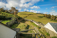 BNPS.co.uk (01202 558833)<br /> Pic: March&Petit/BNPS<br /> <br /> The green, green grass of home. <br /> <br /> A charming clifftop cottage which offers breathtaking views of the English channel has emerged on the market for £450,000.<br /> <br /> Mildmay Cottage, in the fishing village of North Hallsands, Devon, backs on to the scenic South West Coastal Path.<br /> <br /> The front door of the three bedroom early 20th century former fisherman's property is just 4ft from the cliff edge.<br /> <br /> It looks out over Start Bay with its historic early 19th century lighthouse and the spectacular Dartmouth headland.<br /> <br /> The home is for sale with estate agent Marchard Petit who say the area is celebrated for its numerous unspoilt coves and beaches.