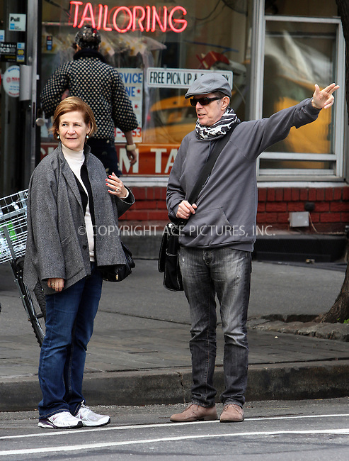 WWW.ACEPIXS.COM....October 18 2012, New York City....Musician David Bowie hails a cab with a female companion in his Soho neighborhood on October 18 2012 in New York City....By Line: Zelig Shaul/ACE Pictures......ACE Pictures, Inc...tel: 646 769 0430..Email: info@acepixs.com..www.acepixs.com
