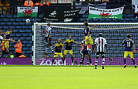 Pictured: Nicolas Anelka of West Brom (L) fails to score with a header after the ball was deflected by Michu of Swansea who jumps in the air (C). Sunday 01 September 2013<br />