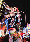 Couple kissing under King Kong's mistletoe at Universal CityWalk in Los Angeles, CA