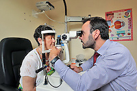12/08/14  Kathleen Moore, mother of Optical Express competition winner, Adrienne Moore has her eyes examined by Rory Dowds, Senior Refractive Optometrist at Optical Express..<br /> Balbriggan mum, Adrienne was so delighted with the results of her lens replacement surgery at Optical Express, that her mum, Kathleen also decided to undergo the procedure. They are both extremely happy with the results, especially Kathleen who had the onset of cataracts and was suffering from increasingly cloudy vision... Picture Colin Keegan, Collins Dublin.