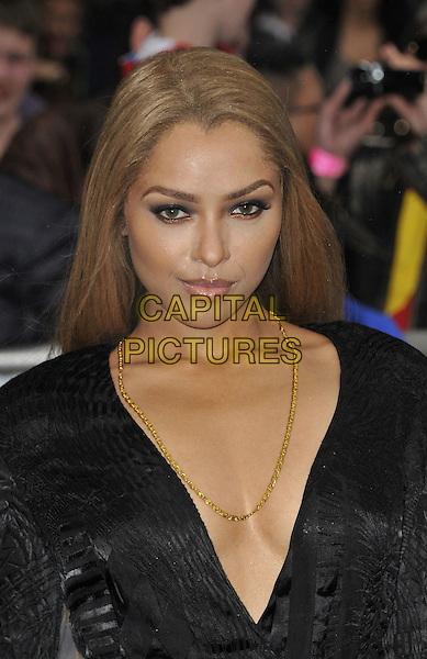 Kat Graham<br /> 'Man Of Steel' UK film premiere, Empire cinema, Leicester Square, London, England.<br /> 12th June 2013<br /> headshot portrait plunging neckline cleavage gold necklace black <br /> CAP/DS<br /> &copy;Dudley Smith/Capital Pictures