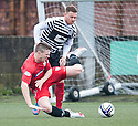 Shire's Iain Thomson gets a yellow card for this challenge on Queen's Park Paul Gallacher.