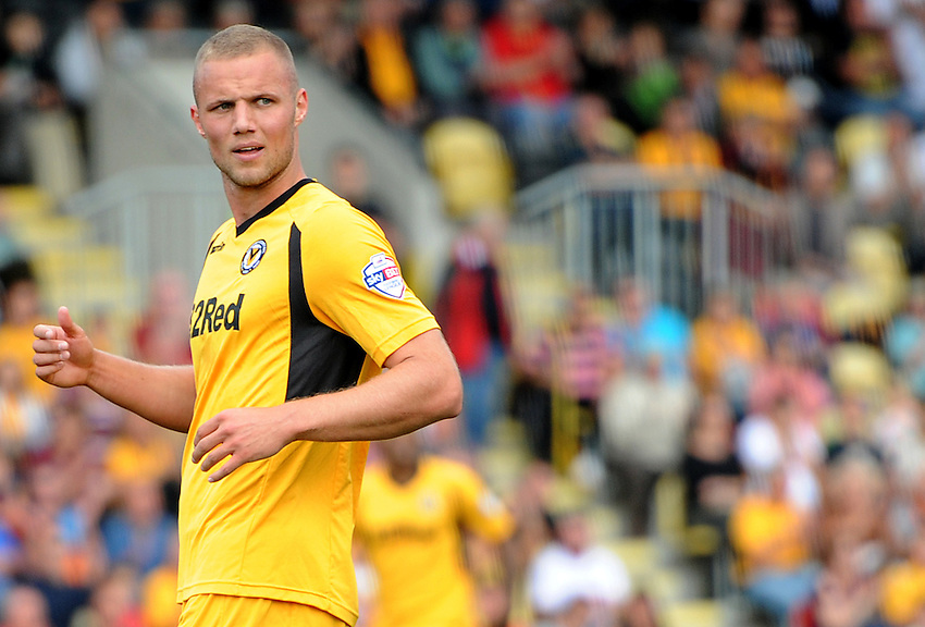Newport County's Harry Worley in action during todays match  <br /> <br /> (Photo by Ashley Crowden/CameraSport)<br /> <br /> Football - The Football League Sky Bet League Two - Newport County v Mansfield Town - Saturday 7th September 2013 - Rodney Parade - Newport<br /> <br /> &copy; CameraSport - 43 Linden Ave. Countesthorpe. Leicester. England. LE8 5PG - Tel: +44 (0) 116 277 4147 - admin@camerasport.com - www.camerasport.com