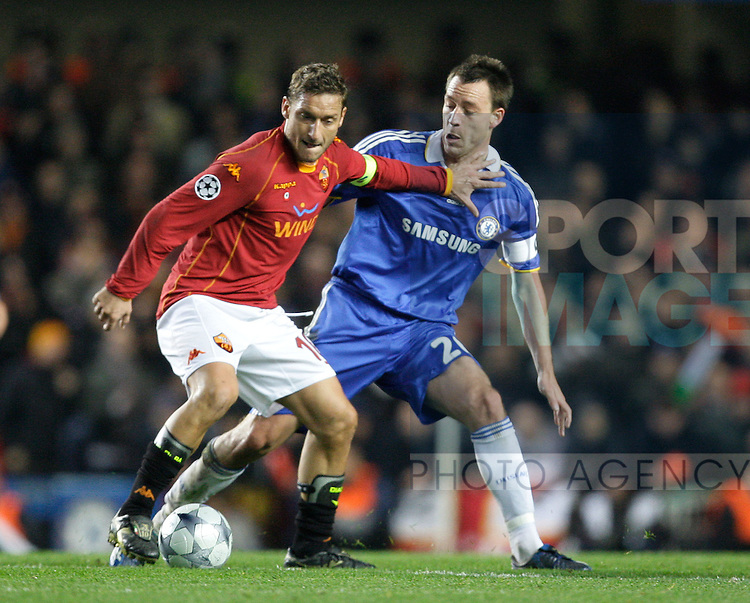AS Roma's Francesco Totti and Chelsea`s John Terry in action.