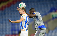 Huddersfield Town's Jon Gorenc Stankovic vies for possession with Lincoln City's John Akinde<br /> <br /> Photographer Chris Vaughan/CameraSport<br /> <br /> The Carabao Cup First Round - Huddersfield Town v Lincoln City - Tuesday 13th August 2019 - John Smith's Stadium - Huddersfield<br />  <br /> World Copyright © 2019 CameraSport. All rights reserved. 43 Linden Ave. Countesthorpe. Leicester. England. LE8 5PG - Tel: +44 (0) 116 277 4147 - admin@camerasport.com - www.camerasport.com