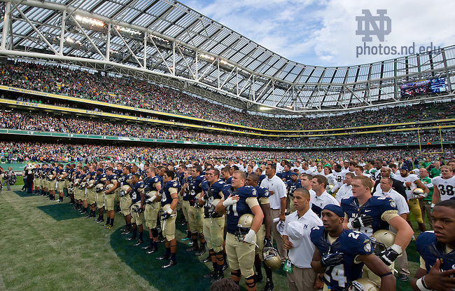Sept. 1, 2012; The Fighting Irish and the Midshipmen stand together for the U.S. Naval Academy Alma Mater after the game at Aviva Stadium, Dublin, Ireland...Photo by Matt Cashore/University of Notre Dame