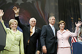 United States President George W. Bush (2nd-R) and his wife first lady Laura Bush along with Vice President Dick Cheney and his wife Lynne wave to supporters during an event at the Ronald Reagan Building, November 3, 2004 in Washington DC. After deciding not to contest the votes in the battleground state of Ohio, Democratic presidential candidate Senator John Kerry (Democrat of Massachusetts) called President Bush to concede and congratulated him.      <br /> Credit: Mark Wilson / Pool via CNP