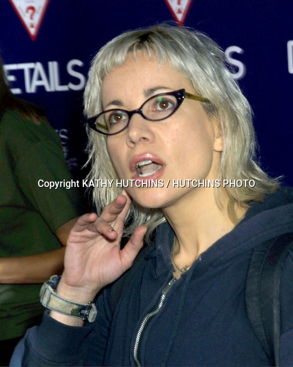 "©2003 KATHY HUTCHINS / HUTCHINS PHOTO.LA PREMIER OF ""WONDERLAND"".GRAUMAN'S CHINESE THEATER.SEPTEMBER 24, 2003..JANEANE GAROFALO"