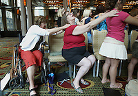 """Pat Hirsch (PAT HIRSCH), center, savors a backrub from fellow Southern Arizona Women's Chorus member Judy Guidotti (JUDY GUIDOTTI) during a rehearsal at the Grand Hyatt in New York, NY on Friday, June 23, 2006.  The Chorus performed Brusa's """"Missa pro defunctis"""" and Beach's """"The Rose of Avontown, Op. 30"""" at Carnegie Hall on Sunday night."""