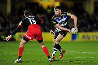 Ollie Devoto of Bath Rugby looks to pass the ball. Aviva Premiership match, between Bath Rugby and Saracens on April 1, 2016 at the Recreation Ground in Bath, England. Photo by: Patrick Khachfe / Onside Images