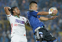 BOGOTA - COLOMBIA -07 -02-2015: Fernando Uribe (Der.) jugador de Millonarios disputa el balón con Carlos Henao (Izq.) jugador de Patriotas FC, durante partido entre Millonarios y Patriotas FC por la fecha 2 de la Liga Aguila I-2015, jugado en el estadio Nemesio Camacho El Campin de la ciudad de Bogota. / Fernando Uribe (R) player of Millonarios vies for the ball with Carlos Henao (L) player of Patriotas FC, during a match between Millonarios and Patriotas FC for the  date 1 of the Liga Aguila I-2015 at the Nemesio Camacho El Campin Stadium in Bogota city, Photo: VizzorImage / Gabriel Aponte / Staff.