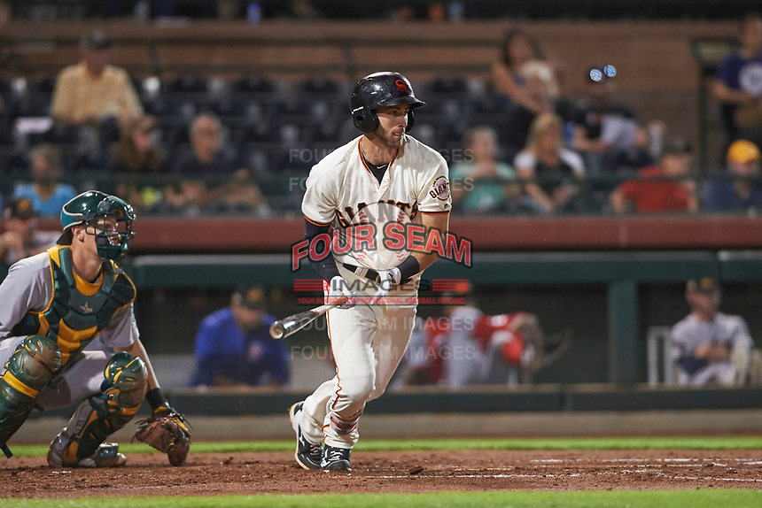 Scottsdale Scorpions center fielder Steven Duggar (1), of the San Francisco Giants organization, follows through on his swing during an Arizona Fall League game against the Mesa Solar Sox on October 23, 2017 at Scottsdale Stadium in Scottsdale, Arizona. The Solar Sox defeated the Scorpions 5-2. (Zachary Lucy/Four Seam Images)