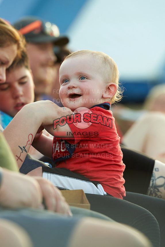 Batavia Muckdogs young fan is all smiles during a game against the Lowell Spinners on July 11, 2017 at Dwyer Stadium in Batavia, New York.  Lowell defeated Batavia 5-2.  (Mike Janes/Four Seam Images)