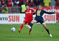 15 April 2010: Toronto FC midfielder Martin Saric #25 and Philadelphia Union midfielder Andrew Jacobson #8 battle for a ball during a game between the Philadelphia Union and Toronto FC at BMO Field in Toronto..Toronto FC won 2-1..Photo by Nick Turchiaro/isiphotos.com.