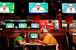 "Rachel and Jarrod Grimm watch Tiger Woods' televised press conference at Somewhere in Augusta Bar, just down the road from where it is being broadcasted live at The Augusta National Golf Course in Augusta, Georgia April 15, 2010. The two followed Tiger Woods on the course for six holes today and said they could tell the crowd was excited to see him. ""You could hear the crowd saying welcome back and he was very receptive,"" Rachel Grimm said."