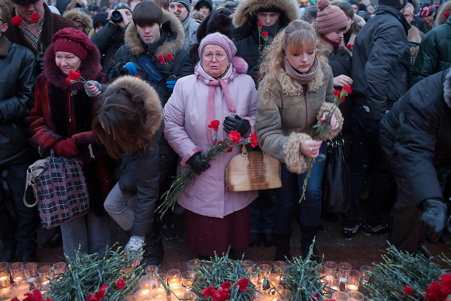 Moscow, Russia, 27/01/2011..A woman weeps as mourners lay flowers at a memorial ceremony in central Moscow for the 35 people killed in the Domodedovo airport bombing.