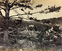 BNPS.co.uk (01202 558833)<br /> Pic: DominicWinterAuction/BNPS<br /> <br /> English Cemetery - the far eastern climate took a heavy toll of European settlers.<br /> <br /> Revealed - A fascinating photo album from the very early days of British Hong Kong...long before the skyscrapers covered it over.<br /> <br /> The 150 year old photos of Hong Kong taken by one of the first British photographers to venture to the Far East have emerged for sale for £15,000.<br /> <br /> John Thomson, who was also a geographer, left Edinburgh for Singapore in 1862 and spent the following decade travelling the region.<br /> <br /> He explored a decidely low-rise Hong Kong from 1868 to 1870, taking numerous pictures of the rapidly expanding settlement and its industrious inhabitants.<br /> <br /> They capture the area, which is currently engulfed in unrest and protest, at a far more tranquil time.<br /> <br /> The photos are being sold with auction house Dominic Winter, of Cirencester, Gloucs.