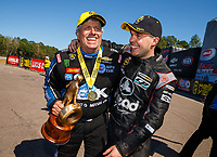 Mar 19, 2017; Gainesville , FL, USA; NHRA funny car driver John Force (left) celebrates with runner up Jonnie Lindberg after winning the Gatornationals at Gainesville Raceway. Mandatory Credit: Mark J. Rebilas-USA TODAY Sports