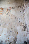 Feint outline of human figure emerging from multiple layers of wall painting, building interior medieval church feature, Inglesham, Wiltshire, England