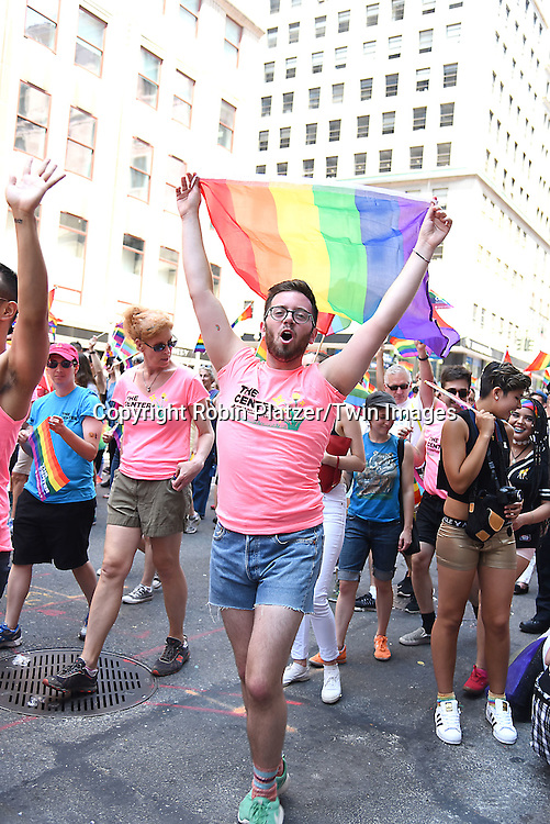 Marchers attends the New York City Gay Pride March 2016 on June 26, 2016 on Fifth Avenue in New York City, New York, USA.<br /> <br /> photo by Robin Platzer/Twin Images<br />  <br /> phone number 212-935-0770