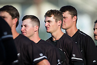Kannapolis Intimidators pitchers (L-R) Alex Katz (20), Jimmy Lambert (12), and Chris Comito (33) stand for the National Anthem prior to the game against the Hickory Crawdads at Kannapolis Intimidators Stadium on May 18, 2017 in Kannapolis, North Carolina.  The Crawdads defeated the Intimidators 6-4.  (Brian Westerholt/Four Seam Images)