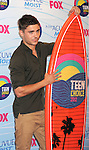 UNIVERSAL CITY, CA - JULY 22: Zac Efron poses in the press room at the 2012 Teen Choice Awards at Gibson Amphitheatre on July 22, 2012 in Universal City, California.