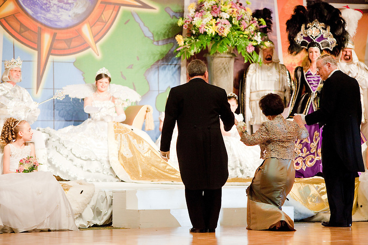 Members of the audience must bow or curtsey when presented to the court at the Krewe of Carrollton's ball in New Orleans on February 5, 2010.