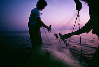 A fisherman pulls in his net full of mullet fish in the Gulf of Mexico. Shining a light on the water in the dark of night <br /> they watch the fish jump. Then it's wild caos as they drive their airboat around in circles, letting out his net to make their catch.