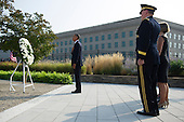 United States President Barack Obama participates in a wreath laying ceremony at the Pentagon in remembrance of the 12th anniversary of the 9/11 terrorist attacks, at the Pentagon on September 11, 2013 in Arlington, Virginia. Obama was joined by Chairman of the Joint Chiefs of Staff General Martin Dempsey and his wife Deanie.  <br /> Credit: Kevin Dietsch / Pool via CNP
