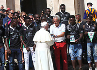 Papa Francesco saluta i membri di una squadra di rugby composta da migranti al termine dell'udienza generale del mercoledi' in Piazza San Pietro, Citta' del Vaticano, 12 settembre 2018.<br /> Pope Francis greets members of the Italian Dog Sports Federation (Federazione Italiana Sport Cinofili FISC) at the end of his weekly general audience in St. Peter's Square at the Vatican, on September 12, 2018.<br /> UPDATE IMAGES PRESS/Isabella Bonotto<br /> <br /> STRICTLY ONLY FOR EDITORIAL USE