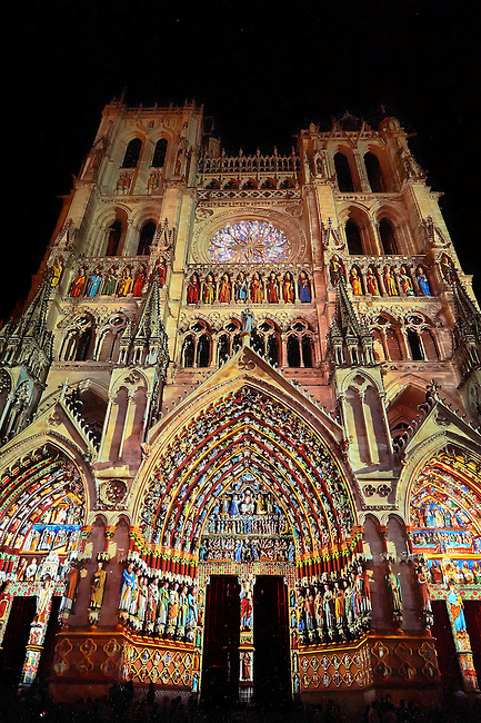 Reconstruction light show of the how the Gothic statues looked on the Gothic Cathedral of Notre-Dame, Amiens, France