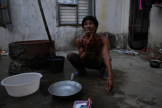 A Filipino man shaves outside his home in Ilocos Norte, Philippines..**For more information contact Kevin German at kevin@kevingerman.com