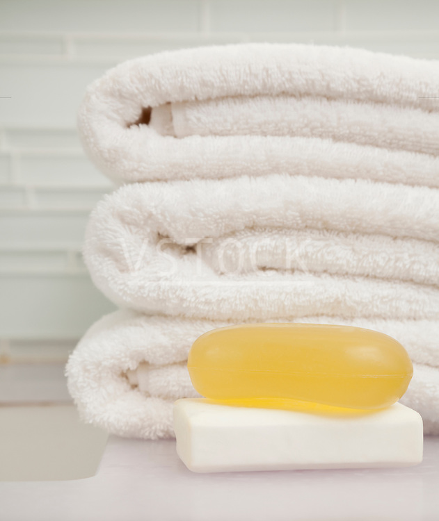 USA, Illinois, Metamora, stack of towels and soaps in bathroom