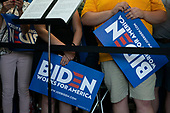 Supporters of 2020 Democratic Presidential candidate Joe Biden hold campaign signs as they listen to Biden speak during the opening of a campaign office in Iowa City, Iowa on Wednesday, August 7, 2019. Biden is kicking off a 4 day tour of Iowa. Credit: Alex Edelman / CNP