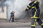 Des pompiers tentent de maitriser l'incendie de l'hotel Ibis, brule par des casseurs pendant la manifestation du 4 avril 2009 contre le sommet de l'OTAN a Strasbourg. Dans ce quartier populaire du Port Autonome, une pharmacie et l'ancien bureau des douanes seront egalement incendies et une station service saccagee..Credit;Hughes Leglise-Bataille/Julien Muguet/face to face