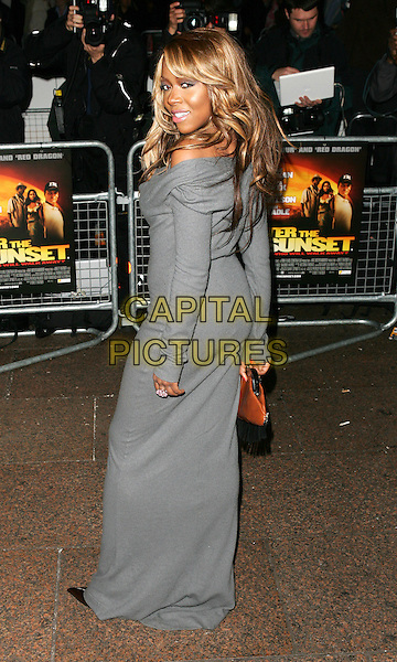 "EBONY THOMAS.Premiere of ""After The Sunset"", Vue Cinema, Leicester Square, London.November 2nd, 2004.full length grey gray dress back behind rear looking over shoulder.www.capitalpictures.com.sales@capitalpictures.com.©Capital Pictures."