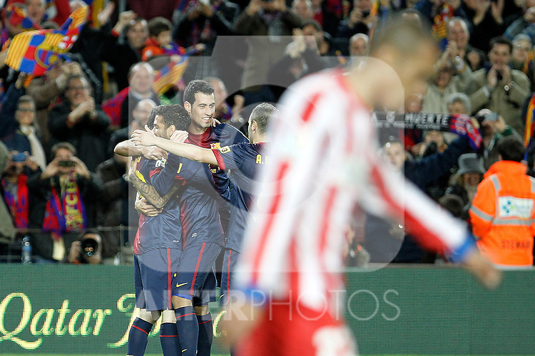 FC Barcelona's Leo Messi, Daniel Alves, Sergio Busquets and Andres Iniesta celebrate goal in presence of Atletico de Madrid's Joao Miranda during La Liga match.December 16,2012. (ALTERPHOTOS/Acero)